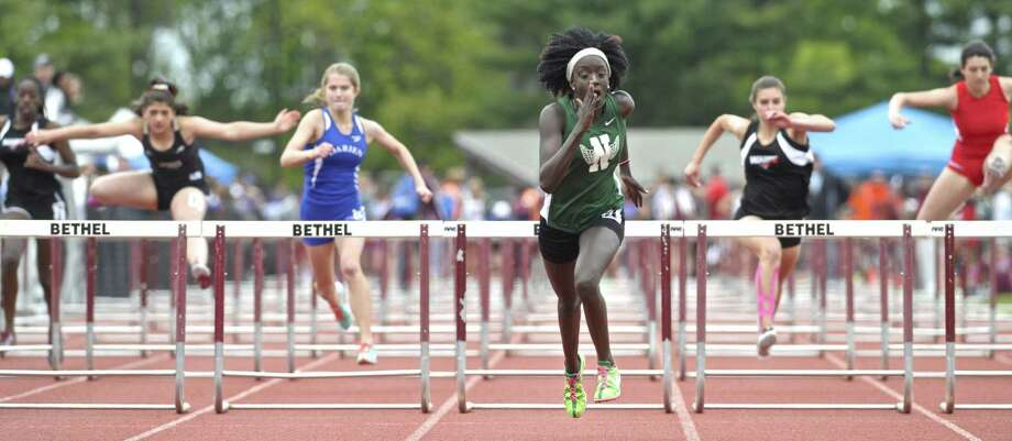 Norwalk's Penda M'Bengue leads the pack to the finish line in the 100 meter hurdles at FCIAC girls track championships, held at Bethel High School, Saturday, May 21, 2016, in Bethel, Conn.