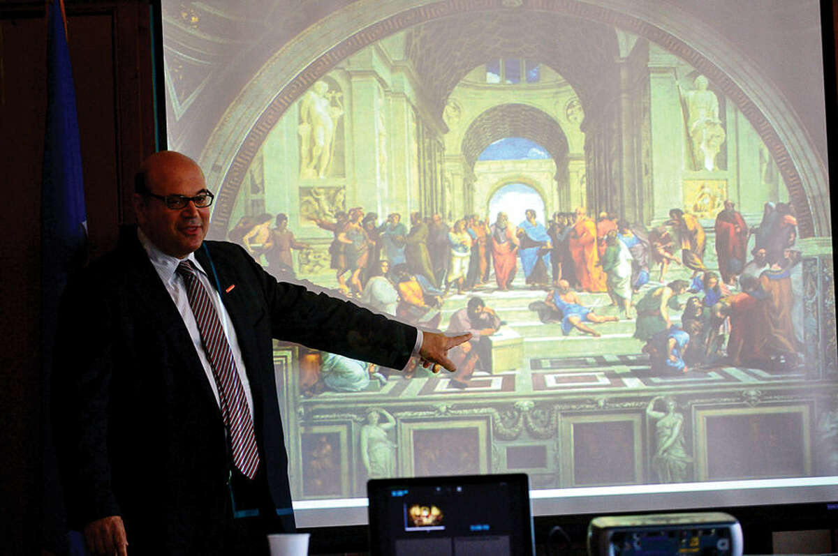 Hour photo / Erik Trautmann Consultant Alex Cohen gives a presentation using Raphael's School of Athens as the Third Taxing District seeks public input on master plan for East Norwalk Library during meeting in Norwalk City Hall's Community Room Saturday.