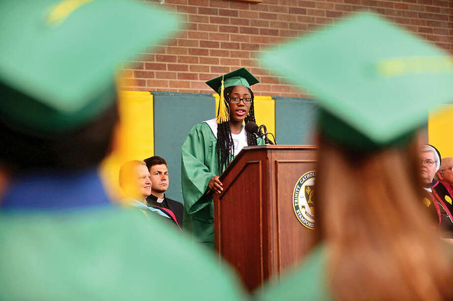 Hour photo / Erik Trautmann Marybelle Raymond gives her Salutorian address during commencement excercises for Trinity Catholic High Schools Class of 2015 Saturday.