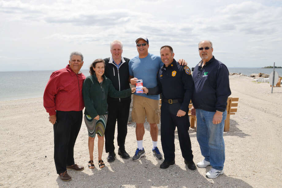 Contributed imageThe first ticket to PAL event sponsor, Melissa and Doug Bernstein, is presented at Compo Beach.