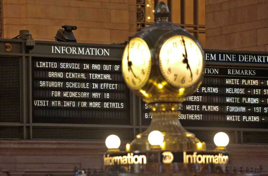 A train information board displays a delay alert for Metro-North trains at Grand Central Terminal, Wednesday, May 18, 2016, in New York. Commuters into and out of terminal faced delays, a day after a fire broke out beneath elevated train tracks in the city.