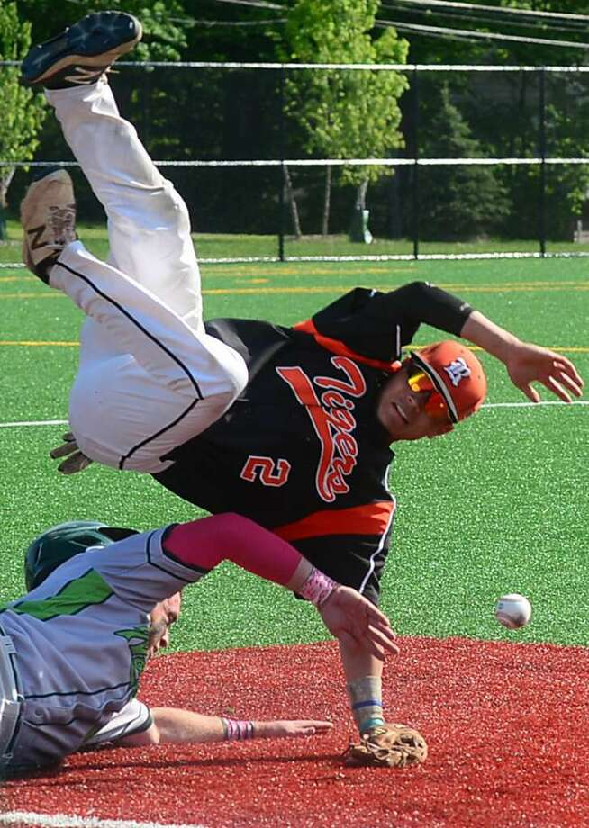Ridgefield High School baseball team's third baseman, Harrison Porter, gets upended by Norwalk's Eddie O'Hara in their FCIAC baseball quarterfinal game in Norwalk, Conn. Friday, May 20, 2016. (Photo: Erik Trautmann / Hearst Connecticut Media)