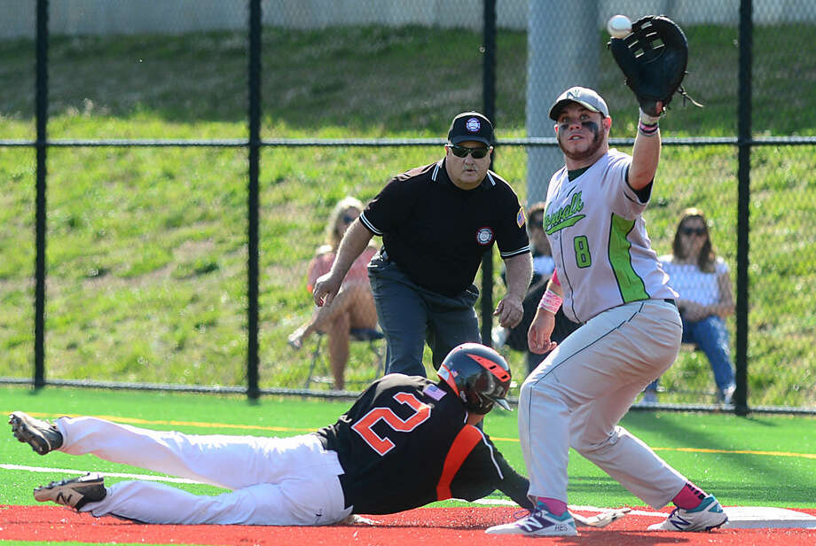 Ridgefield High School baseball team's Harrison Porter gets under the tag of Norwalk's first baseman, Eddie O'Hara, in their FCIAC baseball quarterfinal game in Norwalk, Conn. Friday, May 20, 2016.