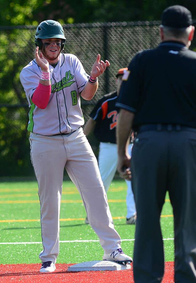 Norwalk High School baseball team's #8 Eddie O'Hara celebrates hitting an RBI in their FCIAC baseball quarterfinal game against Ridgefield in Norwalk, Conn. Friday, May 20, 2016.