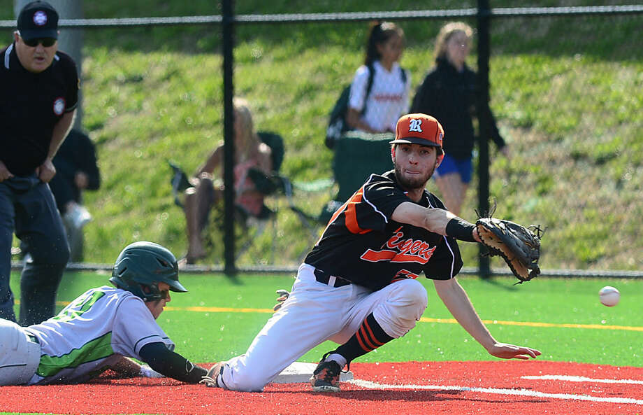 Ridgefield High School baseball team's first baseman Michael O'Brien tries to get the tag on Norwalk's #11 Moe Ortiz-Echevarria in their FCIAC baseball quarterfinal game in Norwalk, Conn. Friday, May 20, 2016.