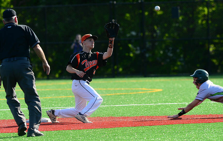 Ridgefield High School baseball team's shortstop Colin Motill waits for the thow before tagging Norwalk's Kyle Mossop in their FCIAC baseball quarterfinal game in Norwalk, Conn. Friday, May 20, 2016.