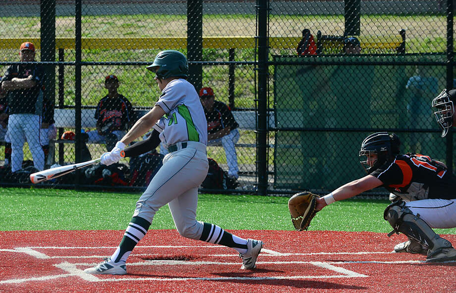 Norwalk High School baseball team's #11 Moe Ortiz-Echevarria hits in their FCIAC baseball quarterfinal game against Ridgefield in Norwalk, Conn. Friday, May 20, 2016.