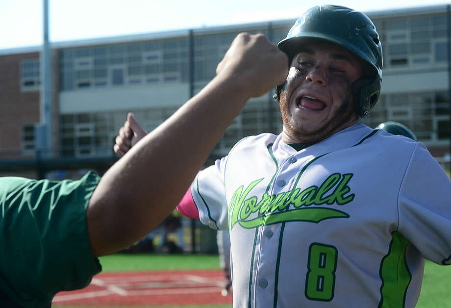 Norwalk High School baseball team's #8 Eddie O'Hara celebrates hitting an RBI in their FCIAC baseball quarterfinal game against Ridgefield in Norwalk, Conn. Friday, May 20, 2016.