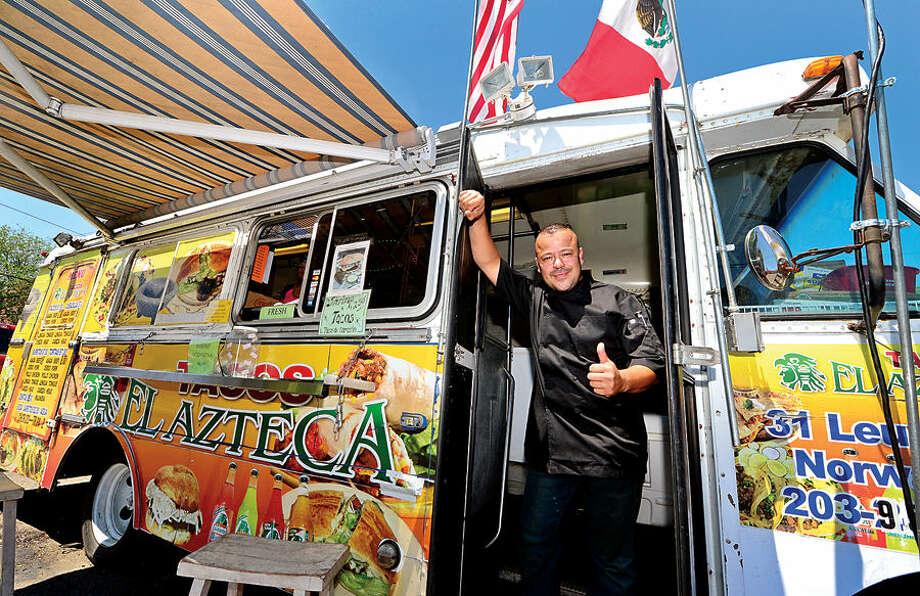 Hour photo / Erik Trautmann Juan Martinez, owner of Tacos el Azteca food truck in Norwalk.