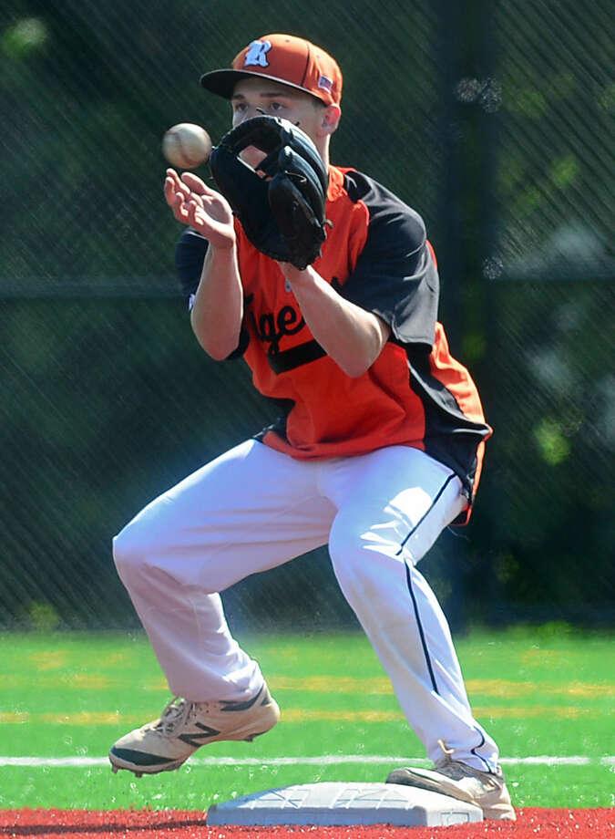 Ridgefield High School baseball battles Norwalk in their FCIAC baseball quarterfinal game in Norwalk, Conn. Friday, May 20, 2016.