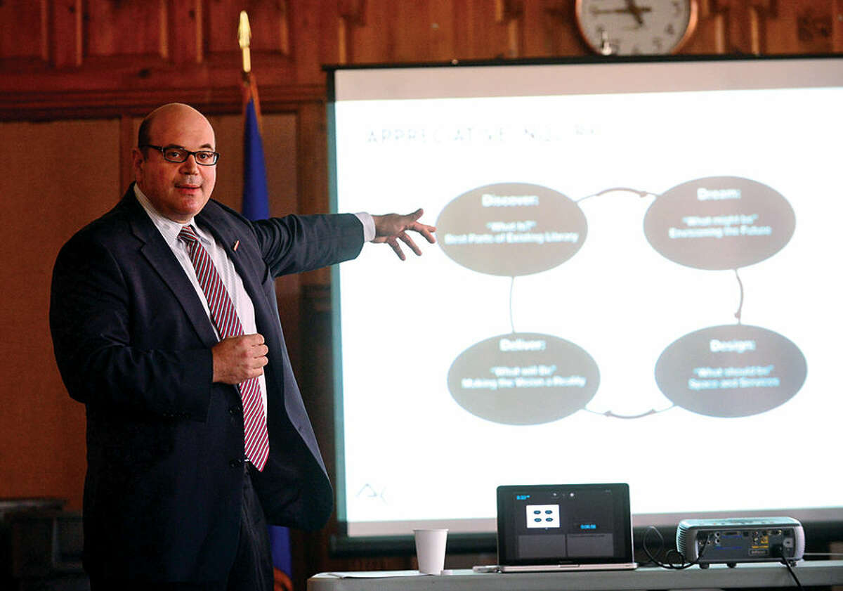 Hour photo / Erik Trautmann Consultant Alex Cohen gives his presentation as the Third Taxing District seeks public input on master plan for East Norwalk Library during meeting in Norwalk City Hall's Community Room Saturday.