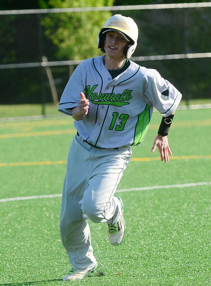 Norwalk High School baseball team's pinch runner Thomas Troy makes it to third in their FCIAC baseball quarterfinal game against Ridgefield in Norwalk, Conn. Friday, May 20, 2016.