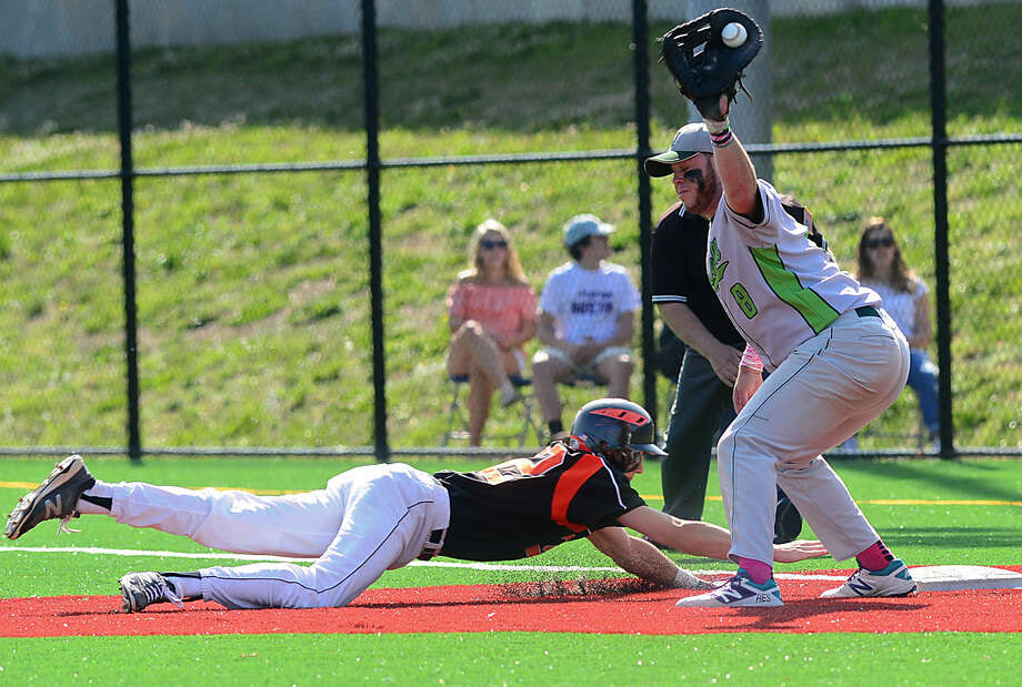 Norwalk High School baseball team's first baseman, Eddie O'Hara, gets his glove on the ball in their FCIAC baseball quarterfinal game against Ridgefield High School in Norwalk, Conn. Friday, May 20, 2016.