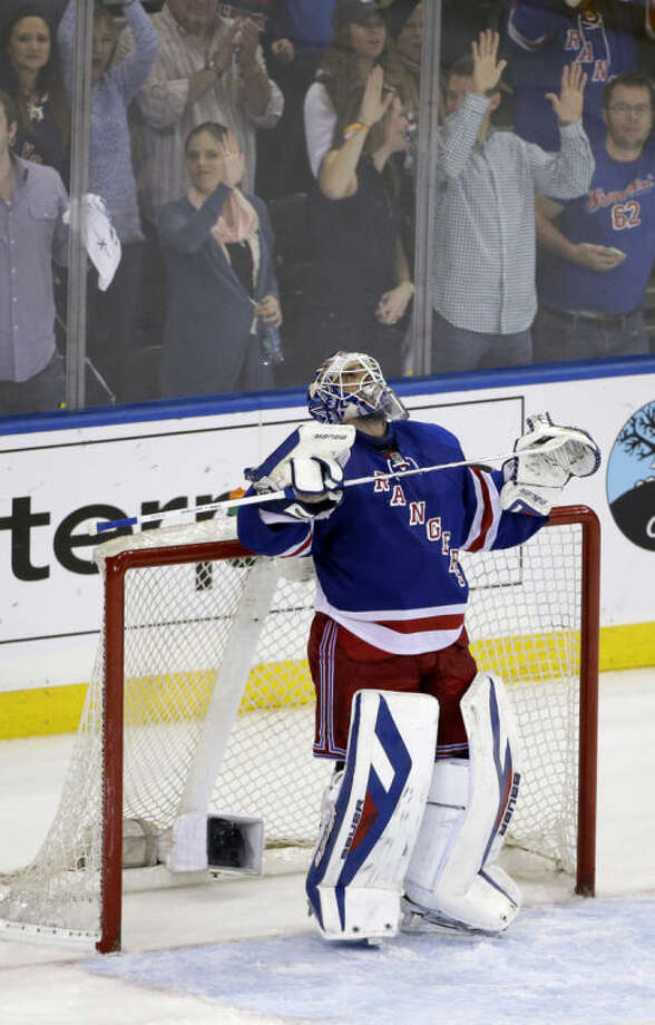 New York Rangers goalie Henrik Lundqvist (30) of Sweden looks up at the scoreboard in the final moments of the third period of Game 6 of a second-round NHL playoff hockey series against the Pittsburgh Penguins, Sunday, May 11, 2014, in New York. The Rangers defeated the Penguins 3-1 and evened up the series at 3 games each. (AP Photo/Seth Wenig)
