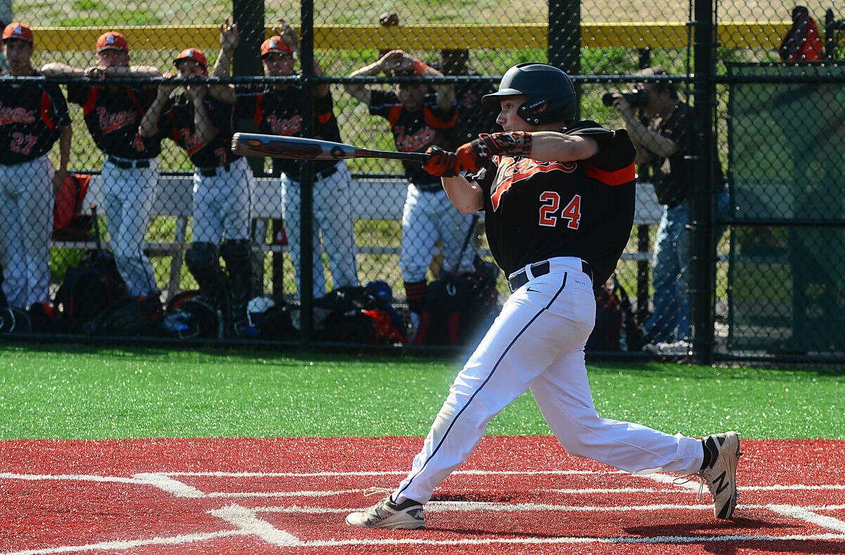 Ridgefield High School baseball team's shortstop Colin Motill hits against Norwalk in their FCIAC baseball quarterfinal game in Norwalk, Conn. Friday, May 20, 2016.