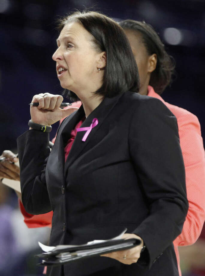 This Wednesday, Feb. 26, 2014 photo shows Ginny Doyle, University of Richmond associate coach, during a game against Virginia Commonwealth University in the Robins Center in Richmond, Va. A university news release says that Doyle and the director of basketball operations were aboard the hot air balloon that crashed after hitting a power line on Friday, May 9, 2014. (AP Photo/Richmond Times-Dispatch, Alexa Welch Edlund)