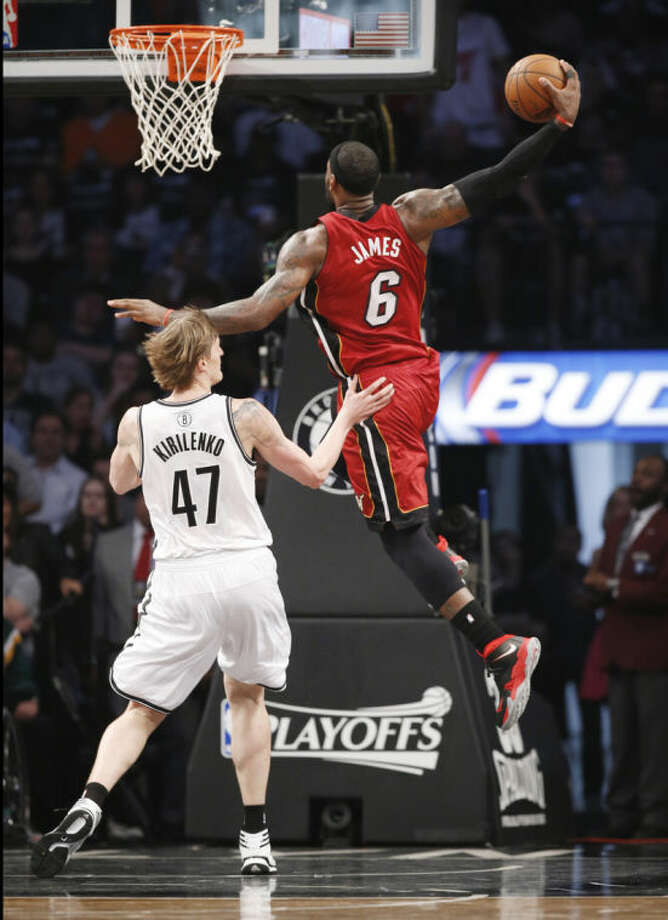 Miami Heat forward LeBron James (6) scores over Brooklyn Nets forward Andrei Kirilenko (47) in the first half of Game 4 of a second-round NBA playoff basketball game at the Barclays Center, Monday, May 12, 2014, in New York. (AP Photo)