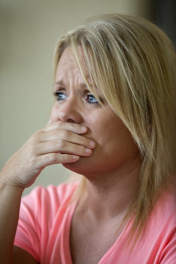 In this may 26, 2015, photo, Tammy Books, a former nurse practitioner, recovering injection drug user and participant in the Perry County Drug Court, gets emotional as she talks about her close calls with death, in Hazard, Ky. Public health officials warn that if the region doesn't get the IV drug abuse problem under control, it's likely to see a Hepatitis C or HIV outbreak. Books says she feels she did not contract Hepatitis C because she had access to new needles during the period she was injecting drugs. She said she was using new needles and then selling them for $5 each to help pay for her drugs. (AP Photo/David Stephenson)