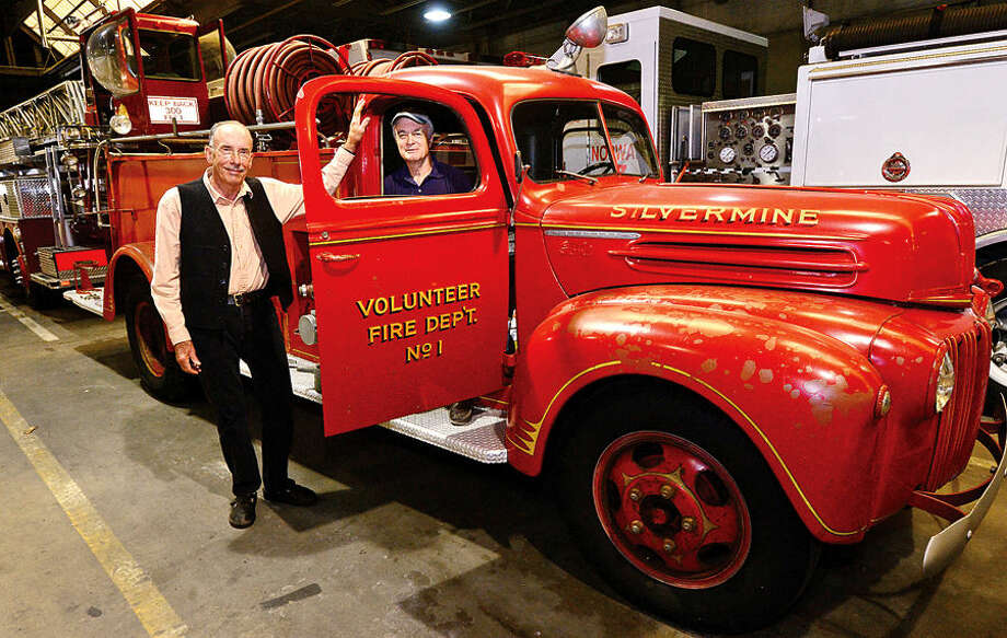 Hour photo / Erik Trautmann The Silvermine Association's Chip Brown and Bruce Cruikshank pose with their antique 1947 Ford Sealand fire truck that is looking for permanent home.