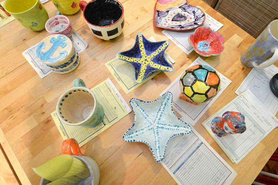 Customers' finished pottery is ready at Happy Hands Art & Pottery in Wilton.