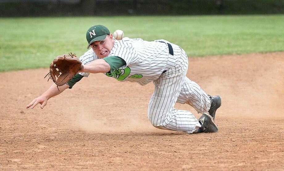 Hour Photo/Alex von Kleydorff Norwalks Eddie O'Hara makes the play at third base vs Wilton