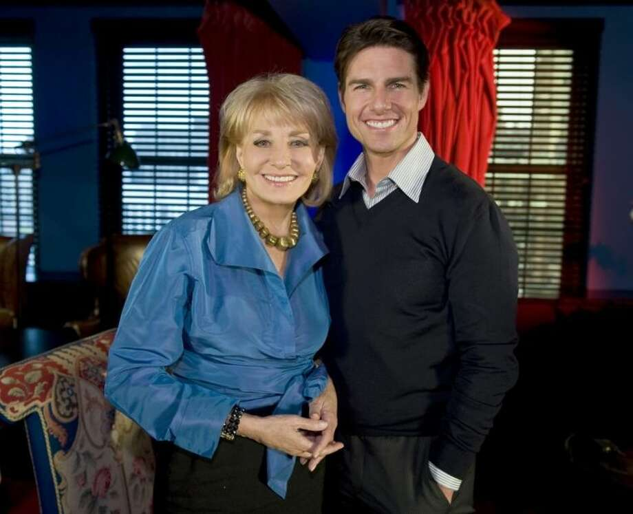 """FILE - In this image released by ABC, Barbara Walters poses with Tom Cruise during an interview for her annual special, """"Barbara Walters Presents: The 10 Most Fascinating People of 2008,"""" that aired on Dec. 4, 2008, on ABC. On Friday, May 16, 2014, capping a spectacular half-century run she began as the so-called """"Today"""" Girl, Walters will exit ABC's """"The View."""" Behind the scenes she will remain as an executive producer of the New York-based talk show she created 17 years ago, and make ABC News appearances as events warrant and stories catch her interest. (AP Photo/ABC, Steve Fenn, File)"""