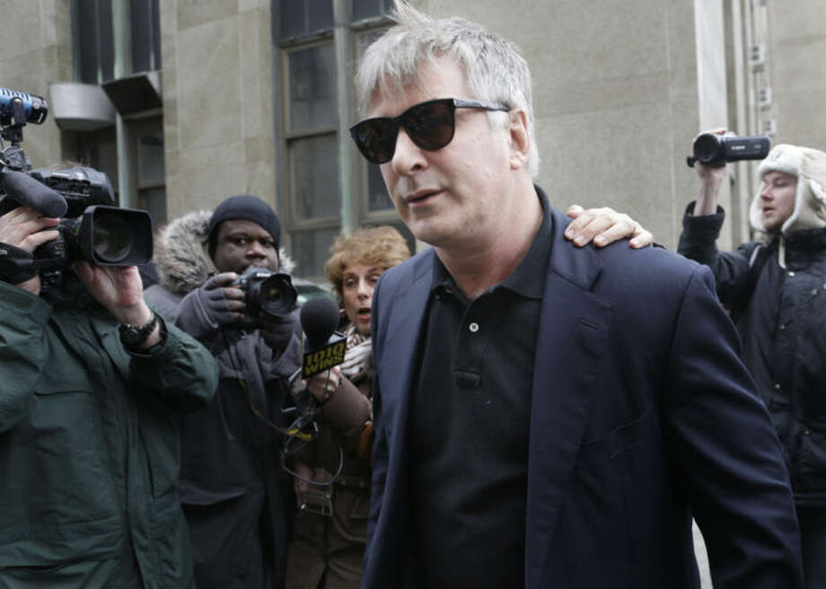 """FILE - In this Tuesday, Nov. 12, 2013 file photo, actor Alec Baldwin leaves criminal court in New York. Police in New York City say actor Alec Baldwin has been arrested for riding a bike the wrong way on the street and acting belligerently toward the arresting officers. Police say the """"30 Rock"""" star was taken into custody Tuesday, May 13, 2014. They say two officers noticed him riding his bicycle the wrong way on 16th Street near Fifth Avenue near Union Square Park. They say the notoriously hot-headed actor was asked to show identification. That's when they say he acted belligerently toward the officers and was arrested. He's since been released. (AP Photo/Seth Wenig, File)"""