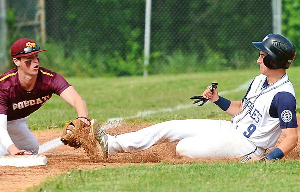 Hour photo / Erik Trautmann South Windsor's third baseman Tyler Sarra tages out Staples High School's Zack Azadian during their Class LLstate tournament game in Westport Thursday.
