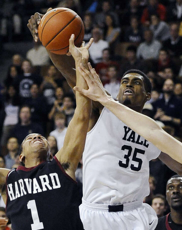 FILE - In this March 7, 2014 file photo, Yale's Brandon Sherrod, right, fouls Harvard's Siyani Chambers, left, during the second half of an NCAA college basketball game in New Haven, Conn. Sherrod is taking off from the team's 2014-15 season to tour with the Whiffenpoofs, the school's a cappella singing group. (AP Photo/Jessica Hill, File)
