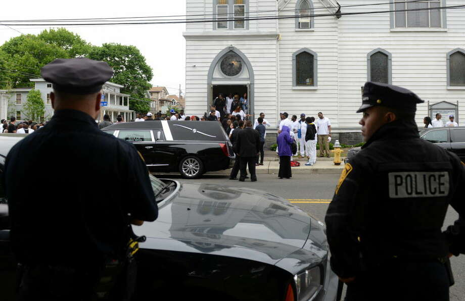 Police stand watch at the funeral of shooting victim Kah'Lil Sloan-Diaz at Calvary Temple Christian Center on Barnum Avenue in Bridgeport, Conn., on Saturday May 21, 2016.