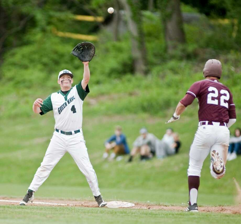 New Milford High School's Riley Zimmerman take the throw at first to get Bethel High School's Jake Roper in a game played at New Milford. Saturday, May 21, 2016