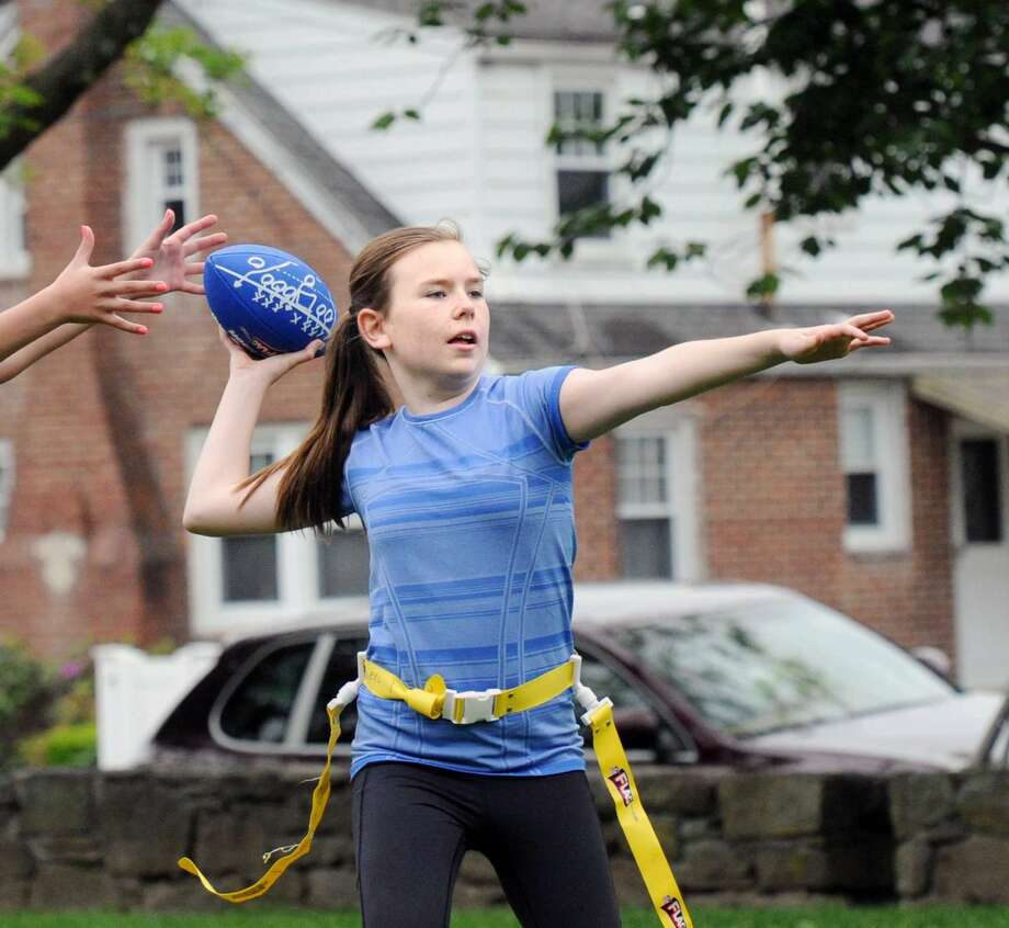 Erin Morlock, 12, plays quarterback during the Chargers flag football practice at Pemberwick Park in the Pemberwick section of Greenwich, Conn., Saturday, May 21, 2016. Charger coaches Tim Harkness and Jim Morlock, said the team is part of the Greenwich Flag Football League that plays their games at Greenwich High School against other teams from the area. Morlock said that their next game is Sunday morning against the Texans.