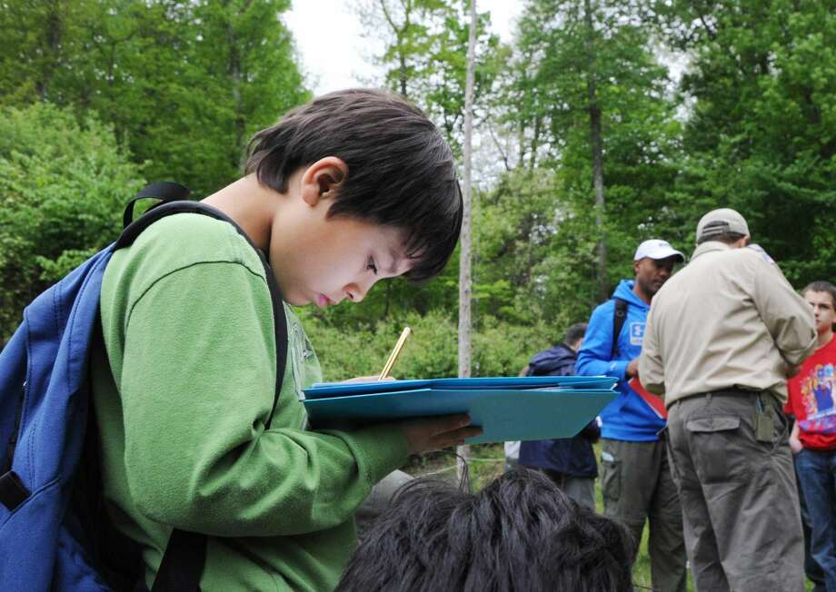 Wilton Cub Scout Daniel Lanaro, 10, solves a math problem during the Cub Scout & Webelos STEM Camporee hosted by Troop 5 of Stamford at the Seton Scout Reservation, Greenwich, Conn., Saturday, May 21, 2016. STEM is an acronym for science, technology, engineering and math. Jim Mitchell of Darien, a Powahay assistant district commissioner, said that the focus of the event was for scouts to learn and acquire skills in the areas of science, technology, engineering and math (STEM). Mitchell said hundreds of scouts form Darien, New Canaan, Norwalk, Stamford and Wilton attended the event.