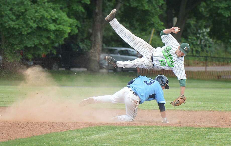 Norwalk's Dave Balunek gets flipped over as Wilton's Jackson Ward slides into second base in the seventh inning. Norwalk defeated Wilton 6-5. (Hour photo/Alex von Kleydorff)