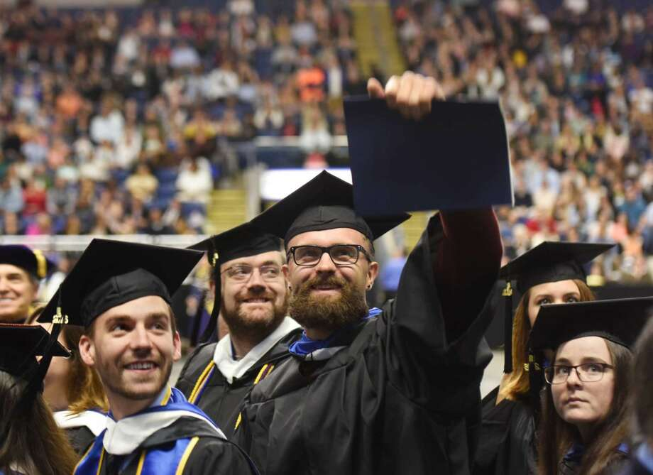 Brookfield resident Matthew Cook, center, looks to the audience during the Western Connecticut State University commencement ceremony at Webster Bank Arena in Bridgeport, Conn. Sunday, May 22, 2016. More than 800 of the university's 1,235 eligible undergraduate candidates participated in the ceremony, along with more than 60 graduate candidates.