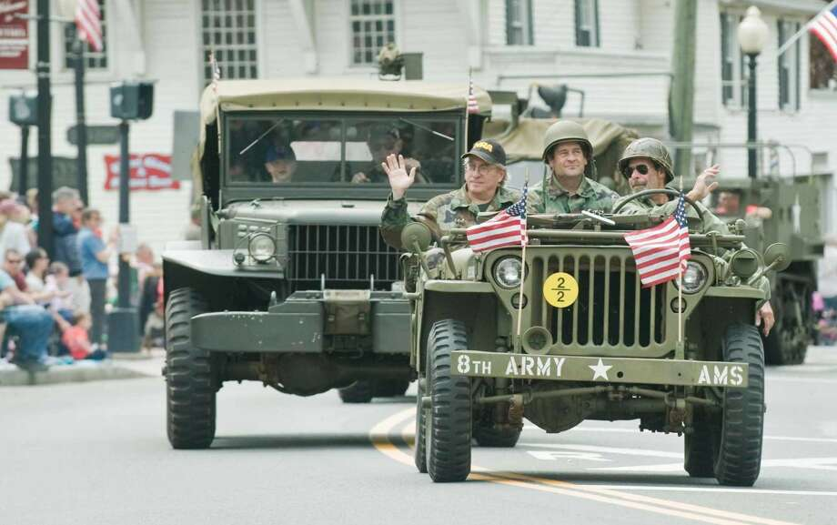 War veterans riding in military hardware in the Bethel Memorial Day Parade on Greenwood Avenue. Sunday, May 22, 2016
