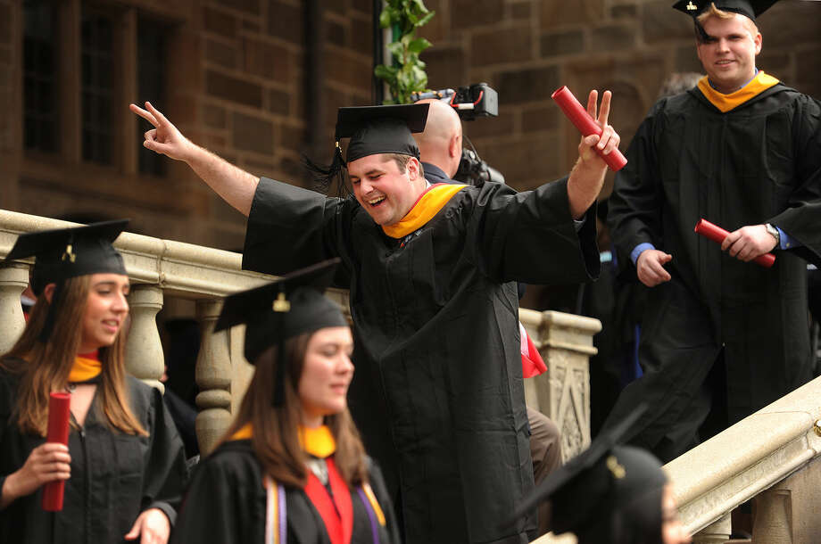 Graduate Seamus Barrett, of Albany, NY, celebrates after receiving his diploma at the Fairfield University graduation in Fairfield, Conn. on Sunday, May 22, 2016.
