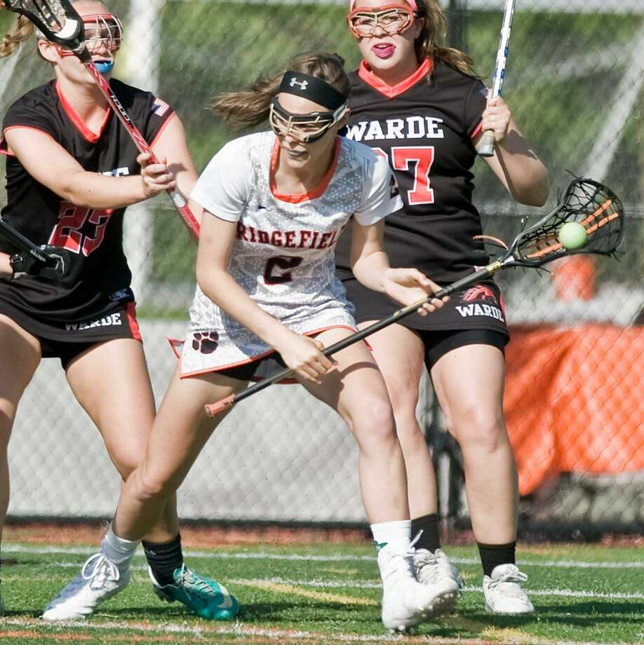 Ridgefield High School's Kimberly Weinstock tries to get through defenders in a game against Fairfield Warde High School, played at Ridgefield. Friday, May 20, 2016