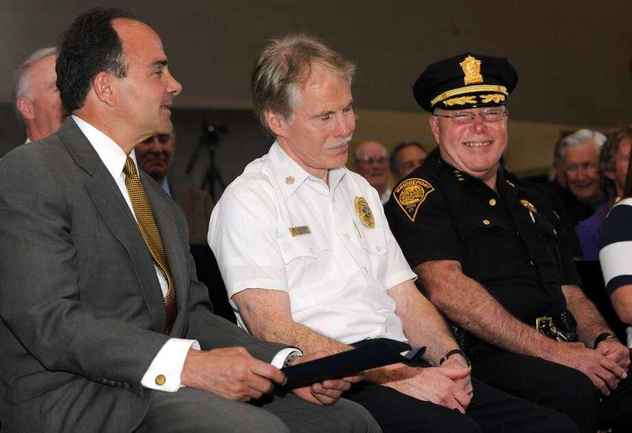 Fire Chief Brian Rooney, seated between Mayor Joe Ganim and Police Chief Armando Perez.