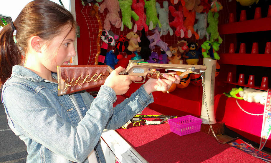 Sophie Denny, of Fairfield, takes a shot in the Crossbow Challenge at the Holy Family Church carnival.