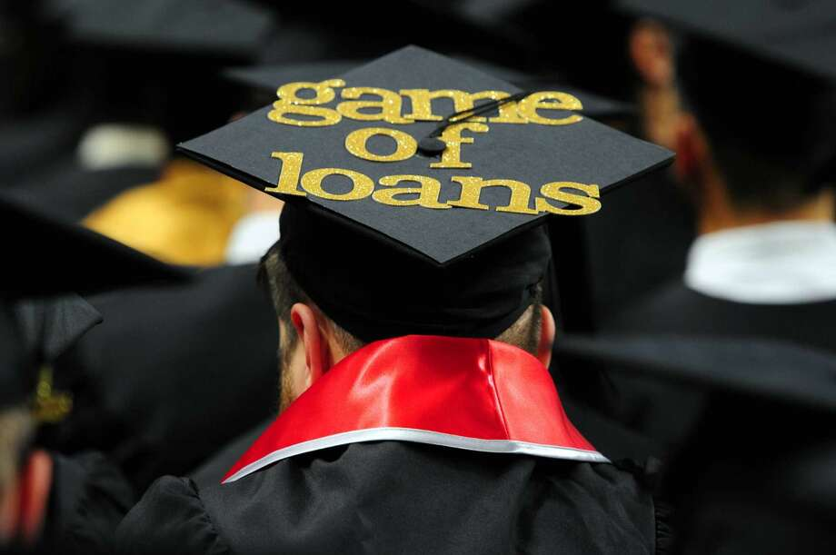 """A graduate's cap is decorated with the words """"Game of Loans,"""" a play on the popular TV show """"Game of Thrones"""" during the commencement."""