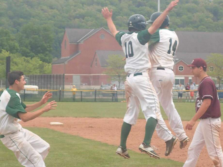 New Milford's Austin Swanson (10) celebrates with teammate Tyler Hansen (14) after Hansen drove in the winning run in the bottom of the seventh inning of the Green Wave's 3-2 victory over Bethel in the South-West Conference baseball quarterfinals at New Milford High School May 21, 2016.