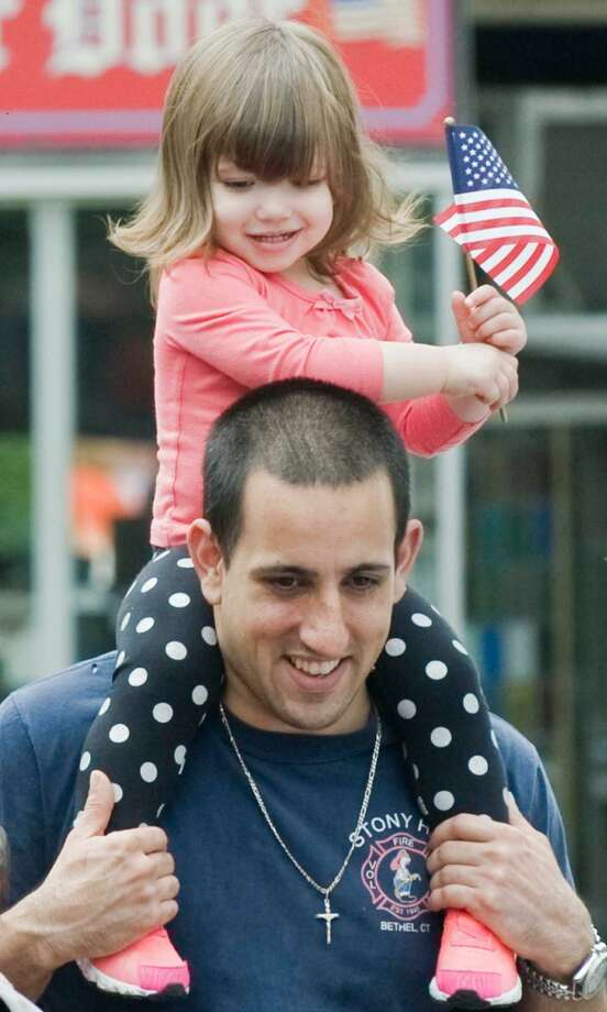 Ariana Occhino, 22 months, enjoys the view on the shoulders of her father, Michael, at the Bethel Memorial Day Parade on Greenwood Avenue. Sunday, May 22, 2016