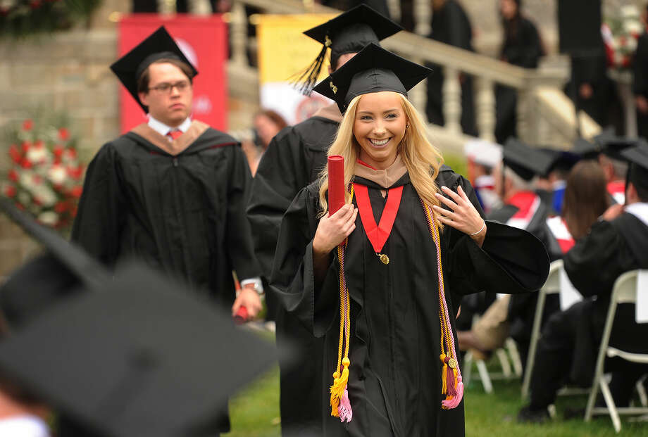Graduate Alyssa Kirby, of Haywood, NJ, is all smiles after receiving her diploma at the Fairfield University graduation in Fairfield, Conn. on Sunday, May 22, 2016.