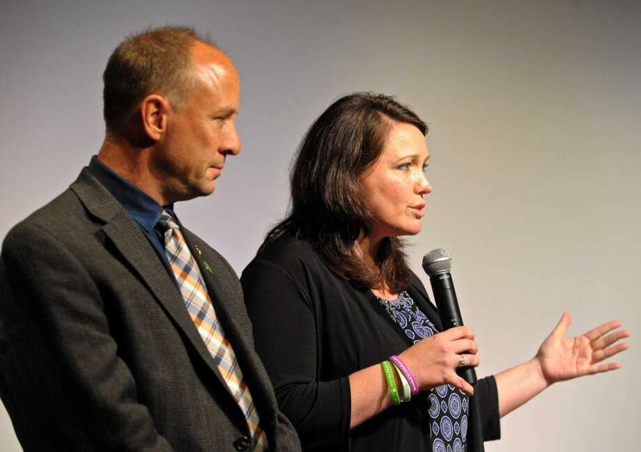 Mark Barden, left, and Nicole Hockey, right, co-founders and Managing Directors of Sandy Hook Promise were at Broadview Middle School to award the school $10-thousand dollars in recognition of its anti-violence efforts. Friday, May 21, 2016, in Danbury, Conn.