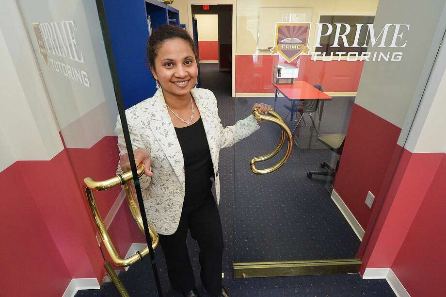 Dotty Josh, director of Prime Tutoring, stands in the entranceway to her Wilton Center office.