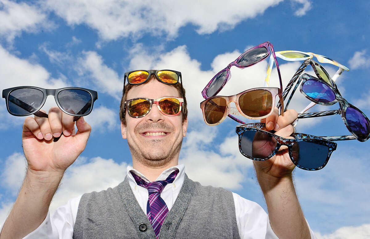 Justin Street, founder of the Stamford-based sunglasses company Canvas Eyewear, shows off some of his customized shades.