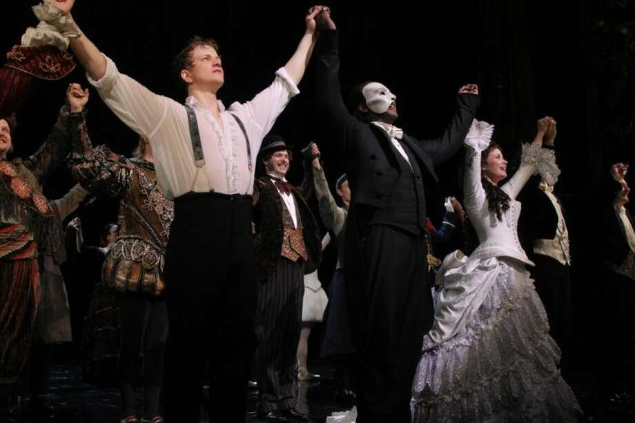 """This May 12, 2014 photo released by The Publicity Office shows, front row from left, Jeremy Hays, Norm Lewis, and Sierra Boggess acknowledging applause on opening night for Lewis and Boggess after the Broadway production of """"The Phantom of the Opera"""" at The Majestic Theatre, in New York. Lewis is the first African-American actor to take on the title role in Broadway's """"The Phantom of the Opera."""" (AP Photo/The Publicity Office, Bruce Glikas)"""