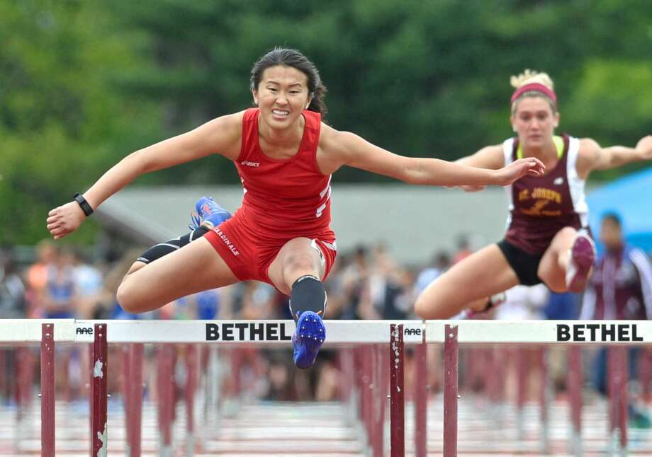Emily Wu runs the 100-meter hurdles for Greenwich during the FCIAC track championships Saturday at Bethel High School.