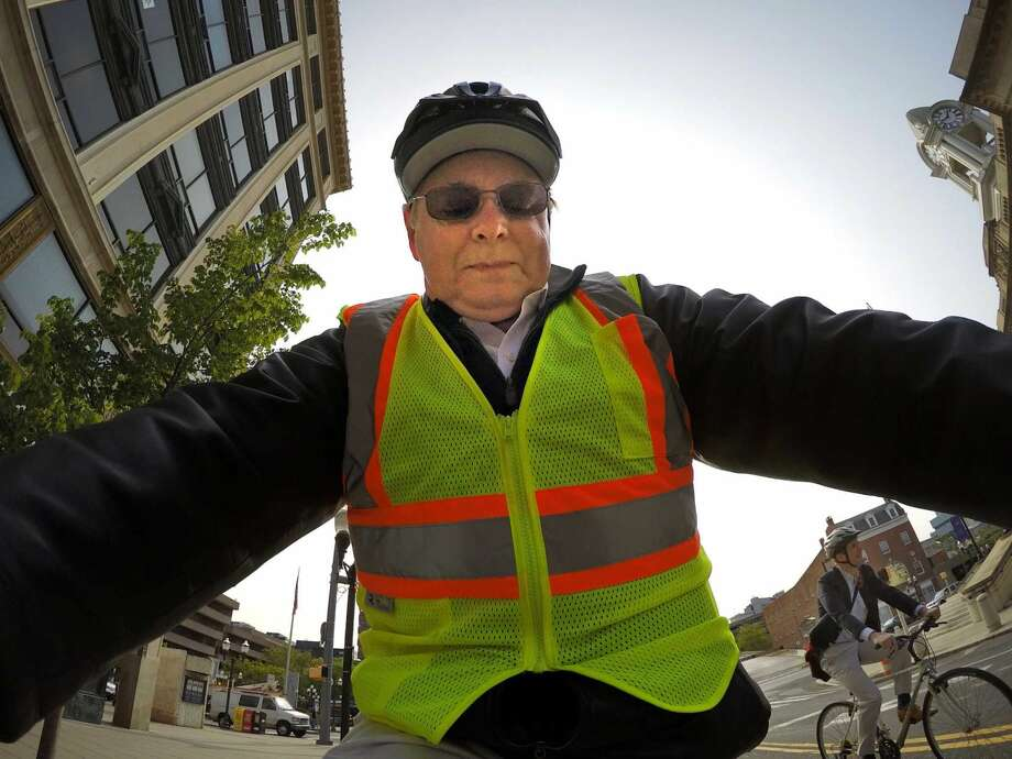 """Stamford Mayor David Martin and U.S. Congressman Jim Himes participate in the """"Ride to Work Day"""" in Stamford, Conn. on Friday, May 20, 2016. Martin was heading down Main Street to his office at the Government Center as Himes zipped past him."""
